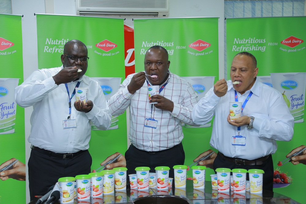 Left: Fresh Dairy officials: Joseph Awino – GM Sales (L), Vincent Omoth – Marketing Manager (C ) and Jonathan Williams (R ) - Operations Manager Production taste and launch the new Brookside Fruit Yoghurt with real fruits coming in 4 flavours: Pear Caramel, Lemon biscuits, Strawberry and Vanilla available countrywide in shops, kiosks, duukas and supermarkets.