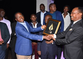 Crown Beverages CEO Mr. Paddy Muramirah (left) and Chairman Board of Directors Mr. Amos Nzeyi (Right) show the ESSA Bottler of the year award to the directors and partners at the celebratory dinner at Windsor Apartments-Kololo on Thursday, 11th July 2019.