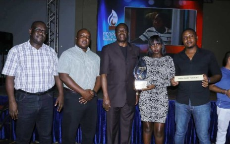 Joseph Awino - General Manager Sales Fresh Dairy(L), Vincent Omoth - Marketing Manager Fresh Dairy (2L), Hon. Micheal Werikhe – Minister of State for Trade (C), Rita Bwiza – Customer Care Executive Fresh Dairy (2R) and Edgar Wabulo – Sales Operations (R ) pose with the People's Choice Award 2019 – Yoghurt Category that Fresh Dairy won. Fresh Dairy Flavoured yoghurt is popular for its thickness, creaminess, aroma, flavours and natural taste.