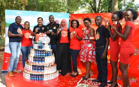 "Innocent Tibayeita (4th R), African Queen Managing Director, Sekar Ramamoorythy (3rd R), Managing Director PZ Cussons East Africa, and staff of African Queen the distributor of Imperial Leather. This was during the media launch of the ""Be Fresh and Win"" consumer reward promo held at The Lawns Restaurant in Kololo, 14th October 2019."