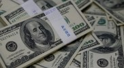 U.S. dollar largely unchanged, Sterling subdued