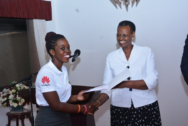 The First Lady and Minister of Education and Sports Janet Museveni handing over a certificate to one of the Seeds for the Future Competition winners.