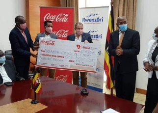 Coca-Cola Beverages Africa in Uganda has handed over its contribution of UGX1.3billion (One Billion, Three Hundred Million Shillings) with three brand new pick-up trucks added to the Ministry of Health COVID-19 fleet.