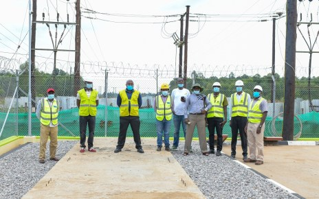 Umeme Managing Director Selestino Babungi inspecting the over sh7b new Tororo rural access line built recently.jpg