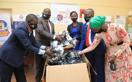UGX10M Donation for Face Masks-UAP OLD MUTUAL