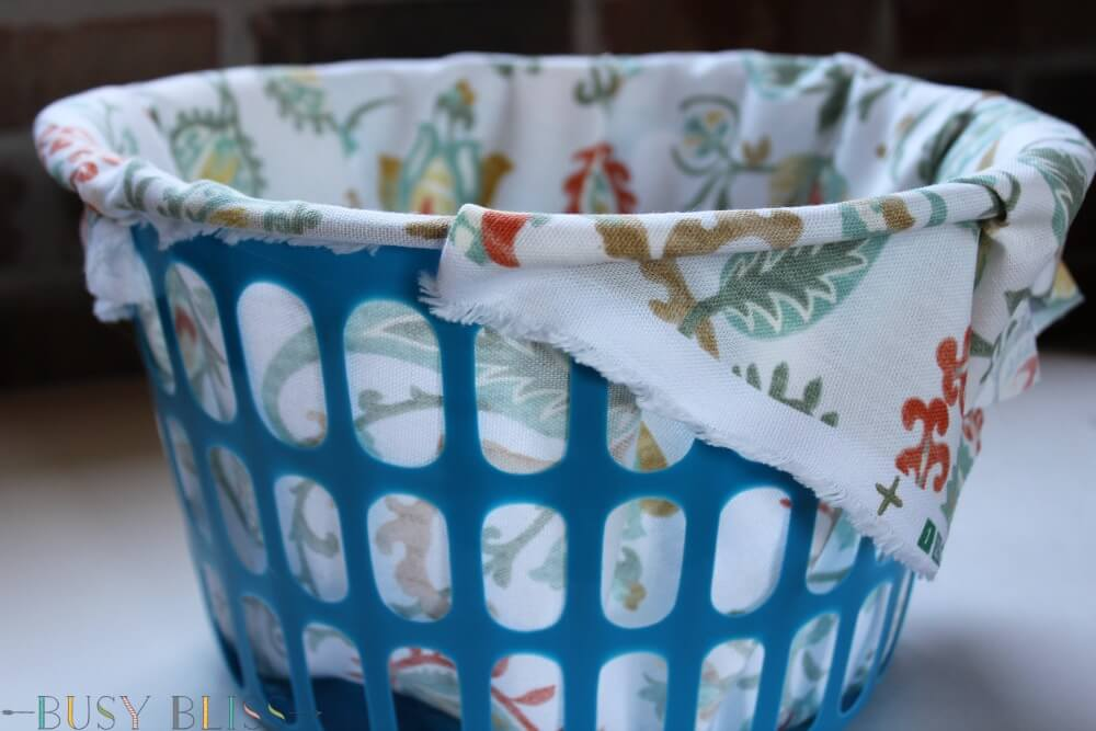 Turn cheap Dollar Tree storage bins into lined woven baskets that look like they came from Pier 1. All you need is some fabric, rope, and a glue gun.