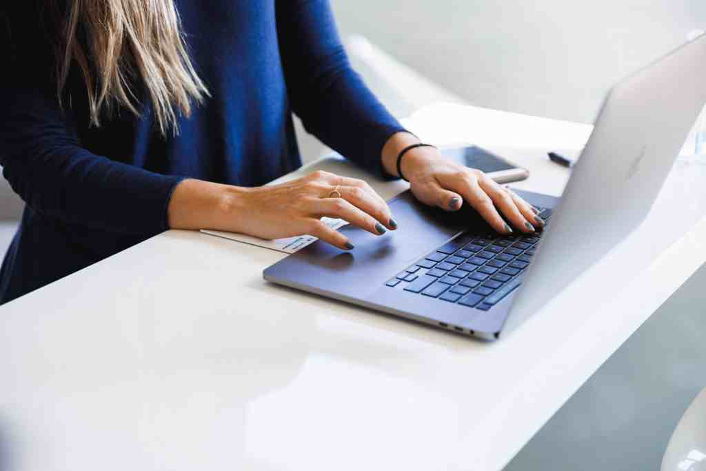 female office worker typing on laptop