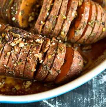 Hasselback sweet potatoes in a baking dish