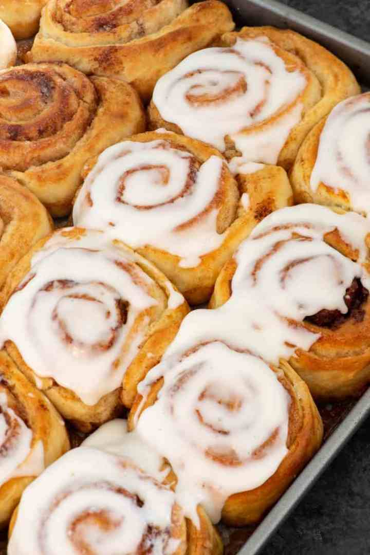 A tray of The Pioneer Woman's Rolls half frosted