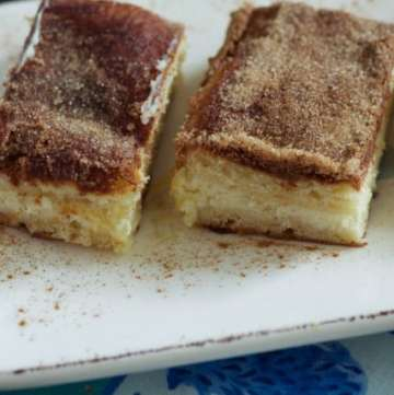 Cinnamon Sugar Cheesecake Bars lined up on a platter