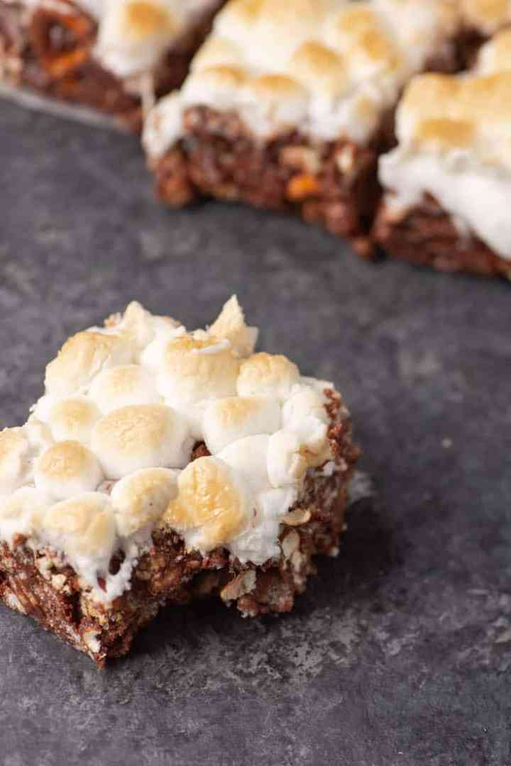 A S'mores Rice Krispie Bar with a bite taken out of it