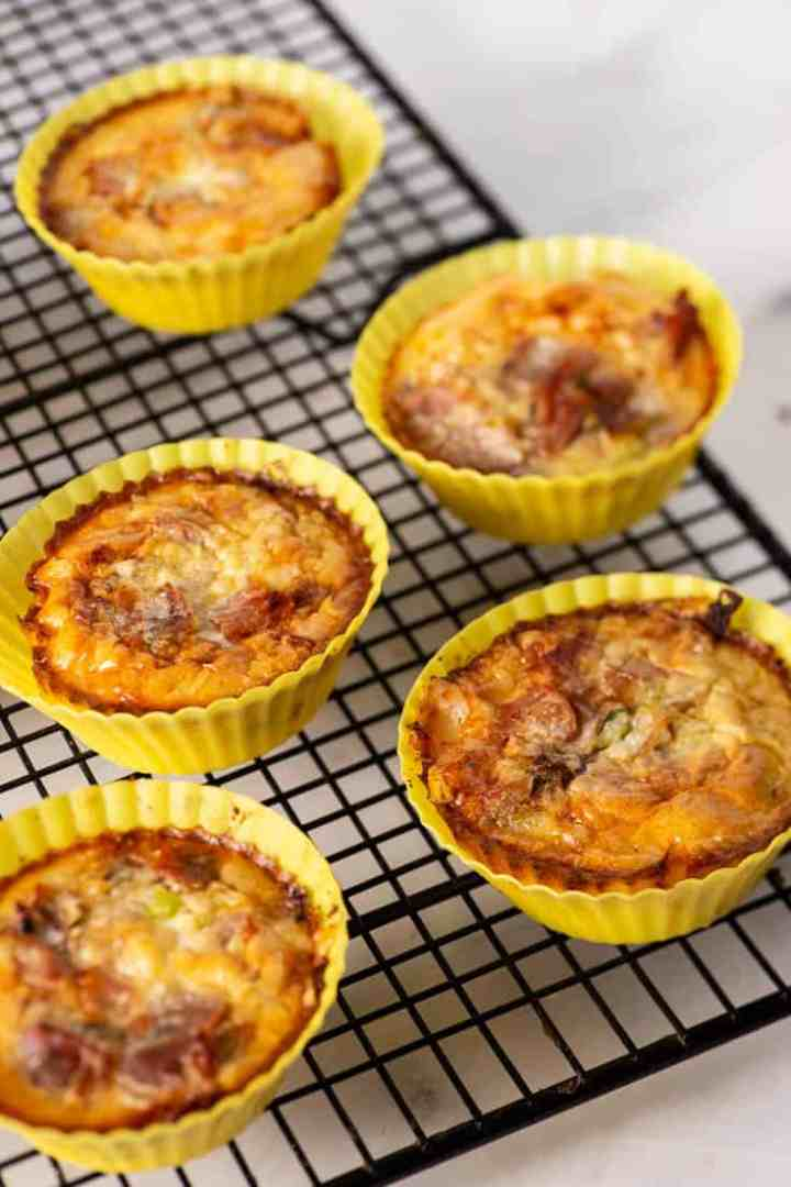 A muffin tin of cooked mini crustless quiches