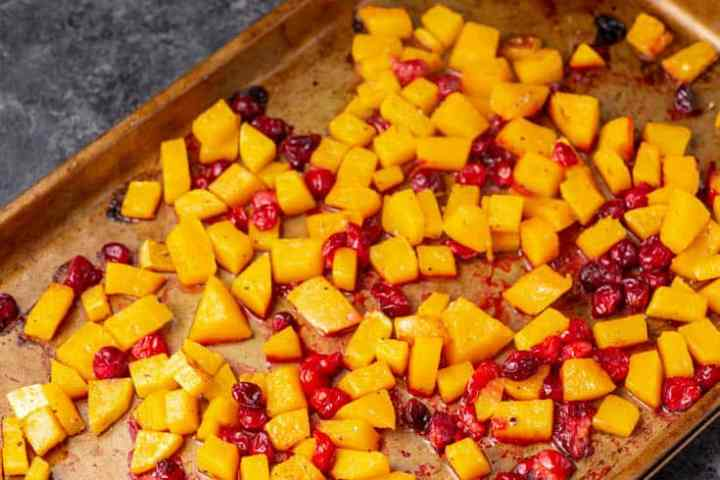 A baking pan of roasted butternut squash and cranberries