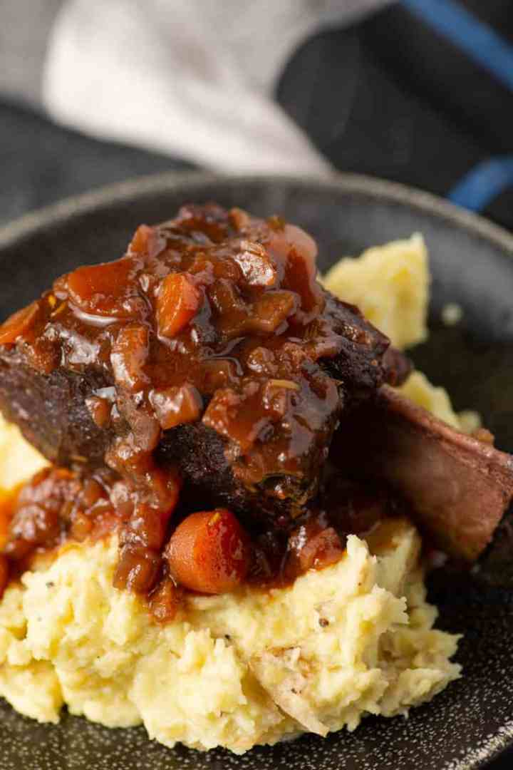 A red wine braised short rib on a bed of mashed potatoes