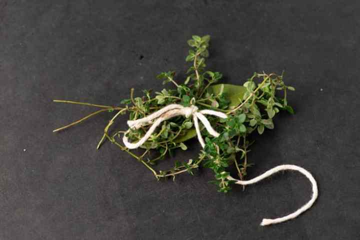 A bunch of thyme and a bay leaf tied with twine