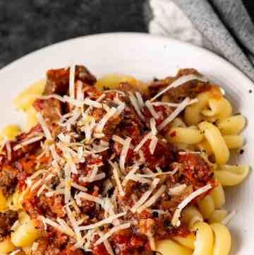 A plate of pork ragu over pasta
