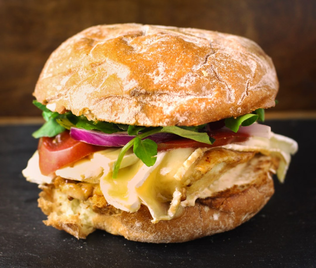 Chicken brie sandwich - not your typical chicken sandwich! The brie brings a nice creamy texture to the sweet savory chicken, the watercress adds a spicy peppery flavor, coupled with tomato and red onion, and it's the perfect combination for a super tasty chicken sandwich. This is perfection! | butterandthings.com