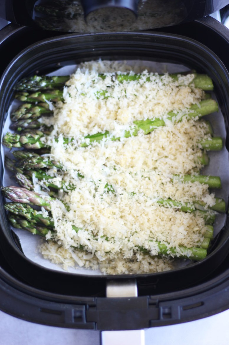 Asparagus topped with breadcrumbs in an air fryer