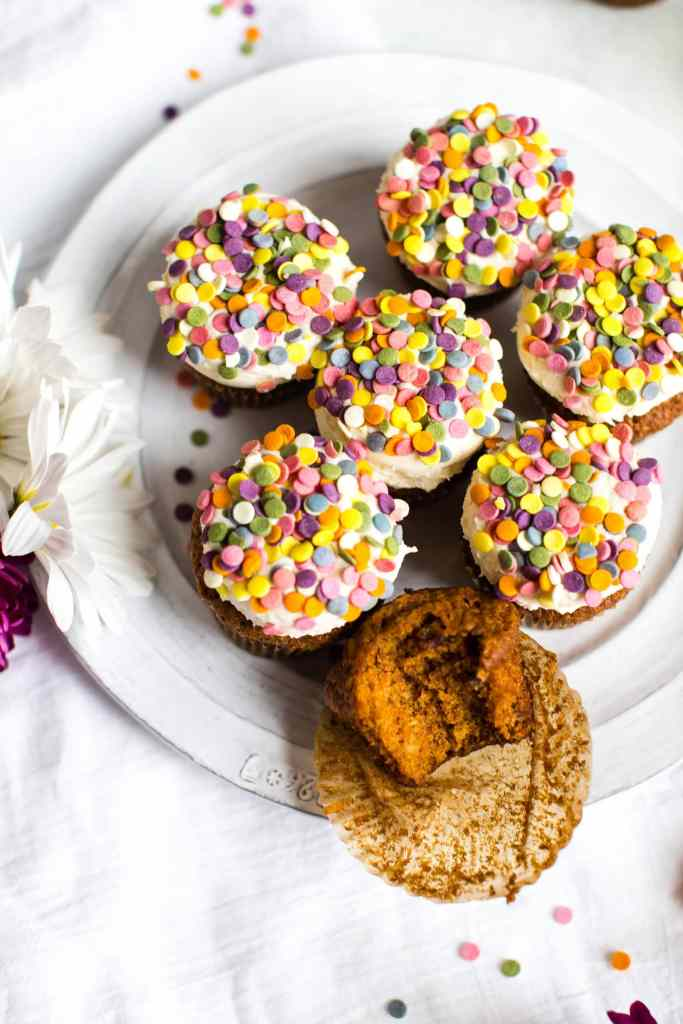 Carrot Cake Cupcakes with Tahini Cream Cheese Frosting on a platter