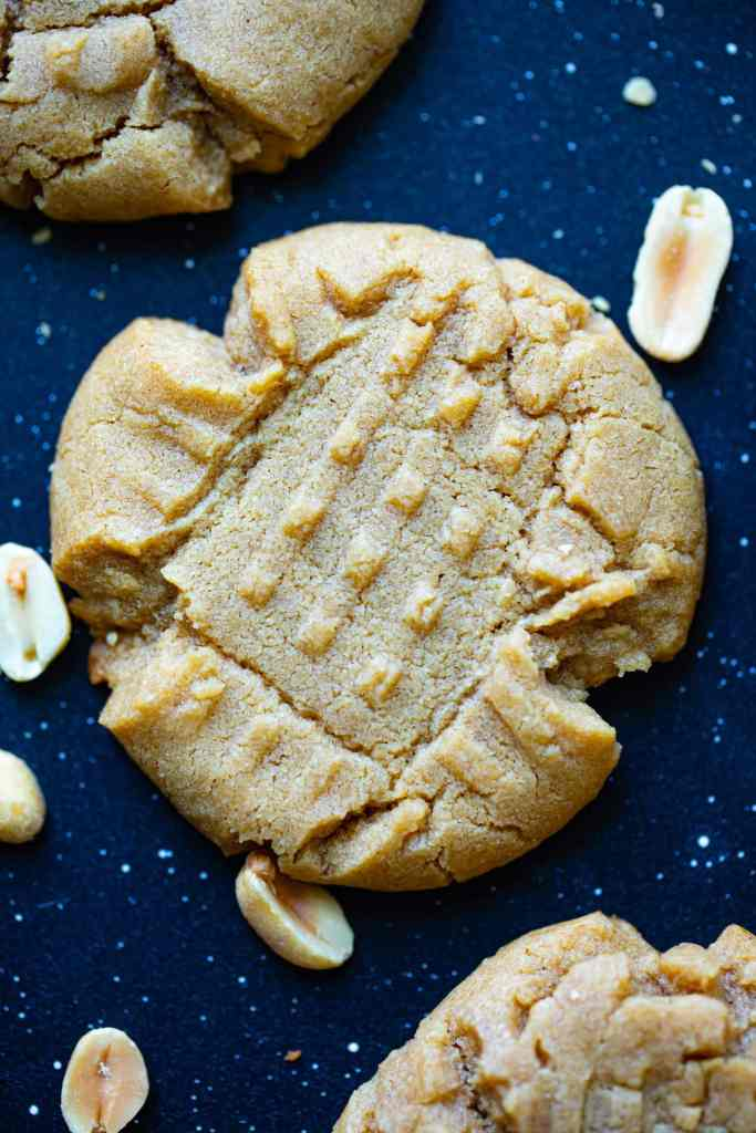close up shot of cookie with crushed peanuts