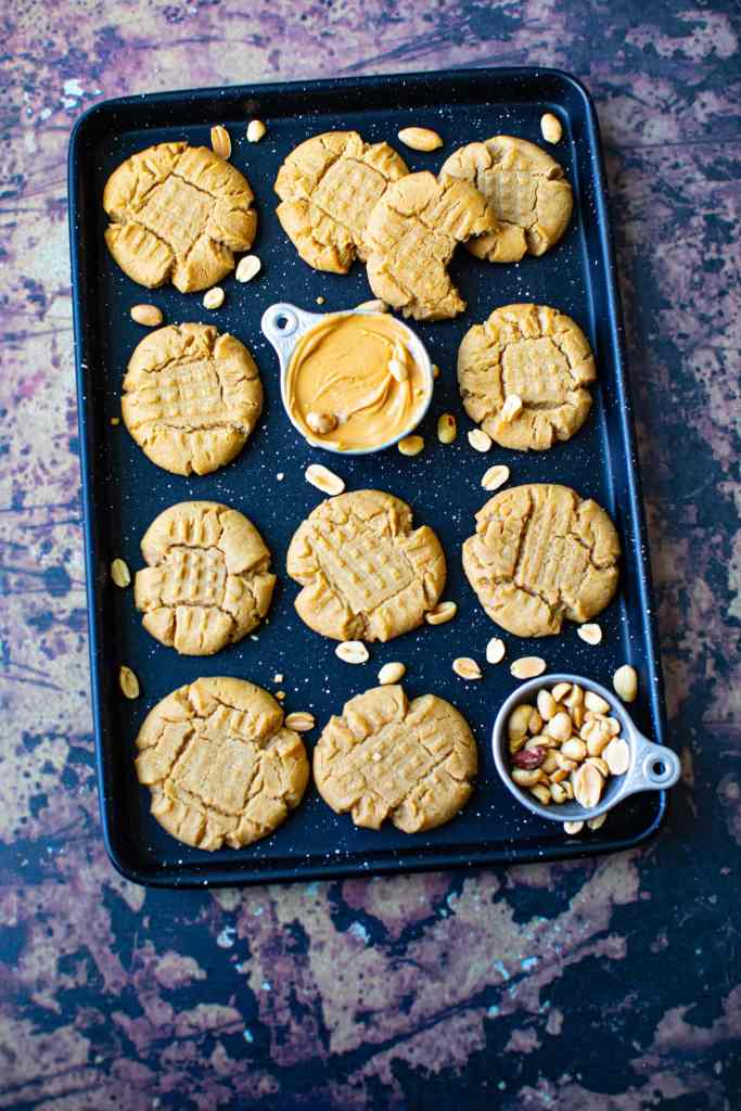 cookies on a speckled black cookie sheet