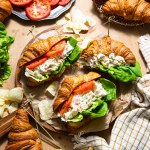 southern style chicken salad in butter croissants on wooden surface