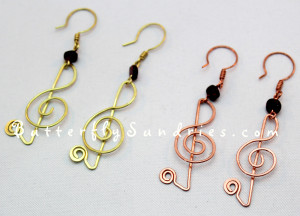 These beautiful treble clef earrings feature garnet beads.... and they're sure to delight the music-lovers on your gift list! They are also available in silver by custom order!