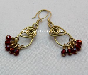 This original handmade brass and glass earring design was inspired by a Port from a winery just outside Ellensburg, WA!