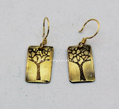 ST Earrings on White Brass