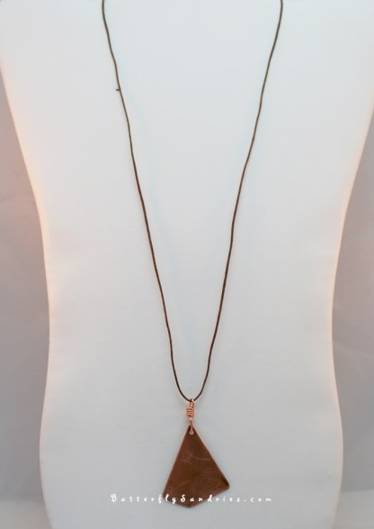 Etched Copper Bascinet Pendant Hanging on White