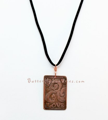 Love CTS Pendant hanging on white