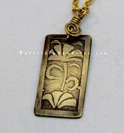 YB Floral Etched Pendant on White Close-up