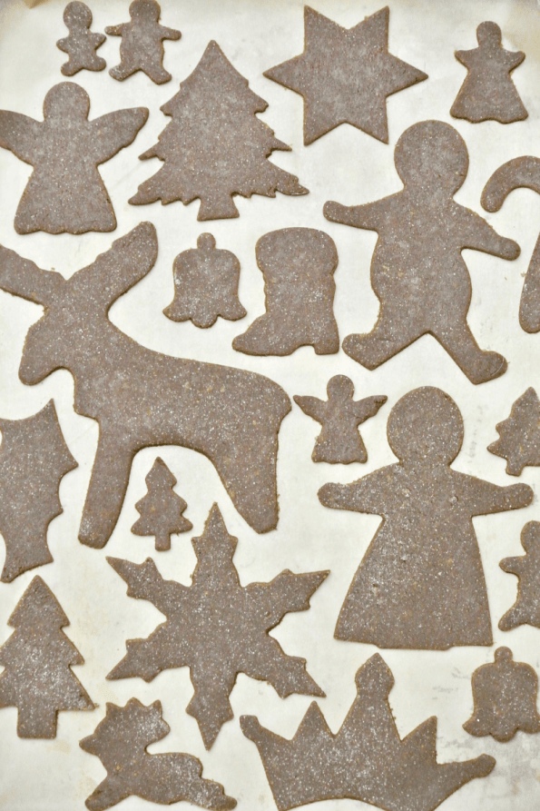 Cutting out the gingerbread shapes.