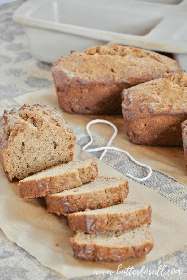 Thick slices of fresh baked sprouted wheat banana bread make a great snack or quick breakfast. Don't for get the real butter! #realfood #sprouted #refinedsugarfree #breakfast #brunch #nutfree #bananabread #easy #fast #wisetraditions #nourishingtraditions