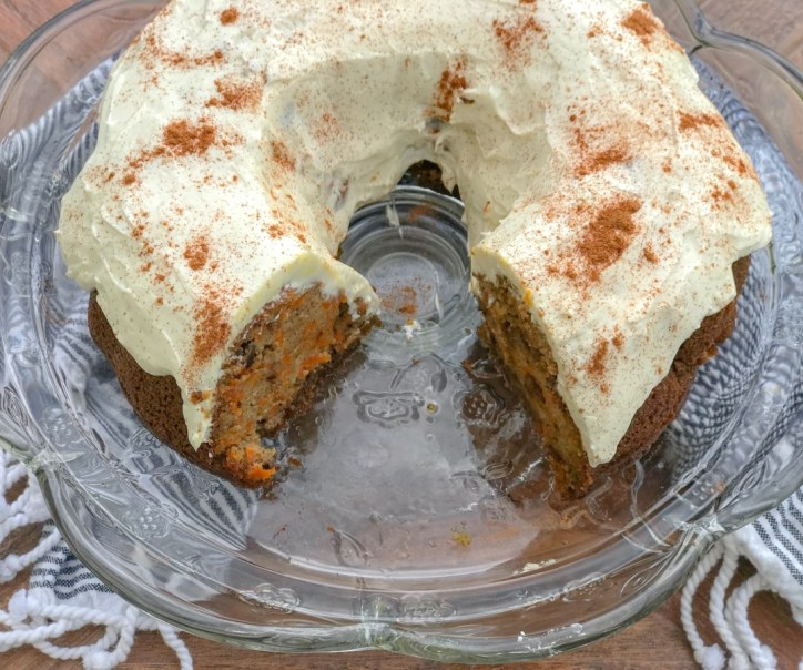 top view of sliced into carrot cake on a cake pan
