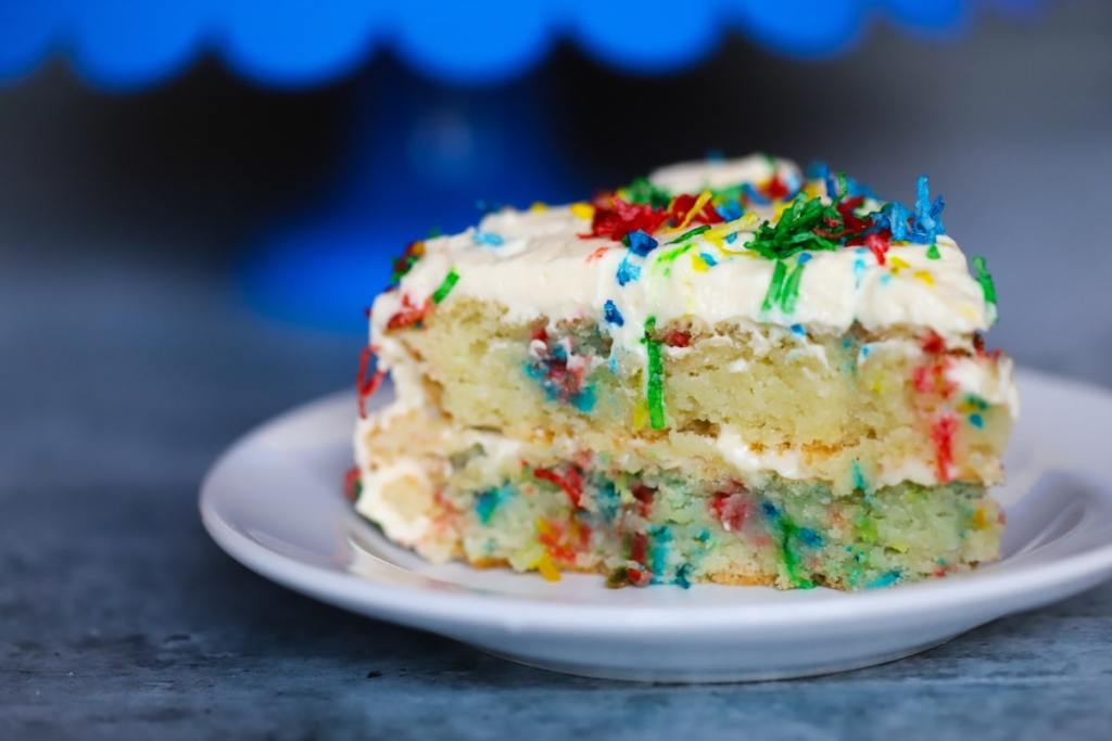 Side View Of A Slice Cake On Plate This Funfetti Keto Birthday