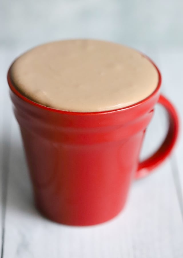 red mug with keto chocolate frosty hovered the top of the mug