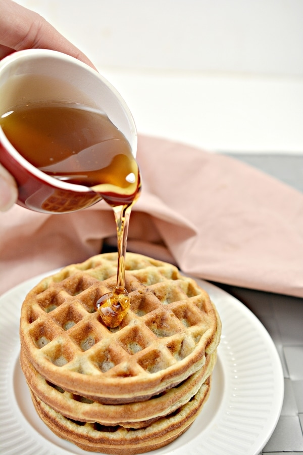 maple syrup being poured onto chaffles