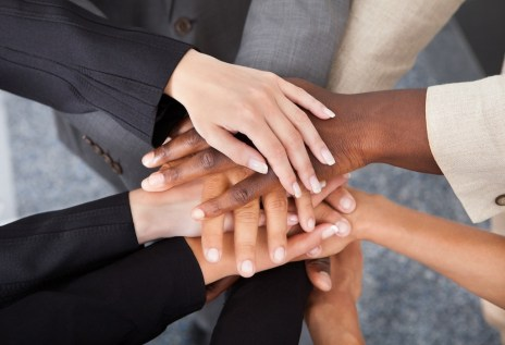 High Angle View Of Multiracial Businesspeople Stacking Hands Over Each Other