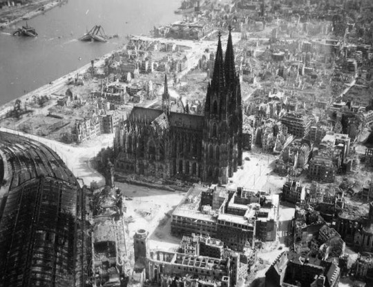 The Cologne cathedral stands tall amidst the ruins of the city after allied bombings, 1944
