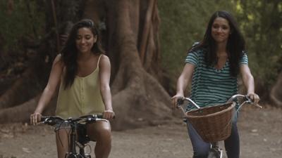 talia-and-emily-on-bikes
