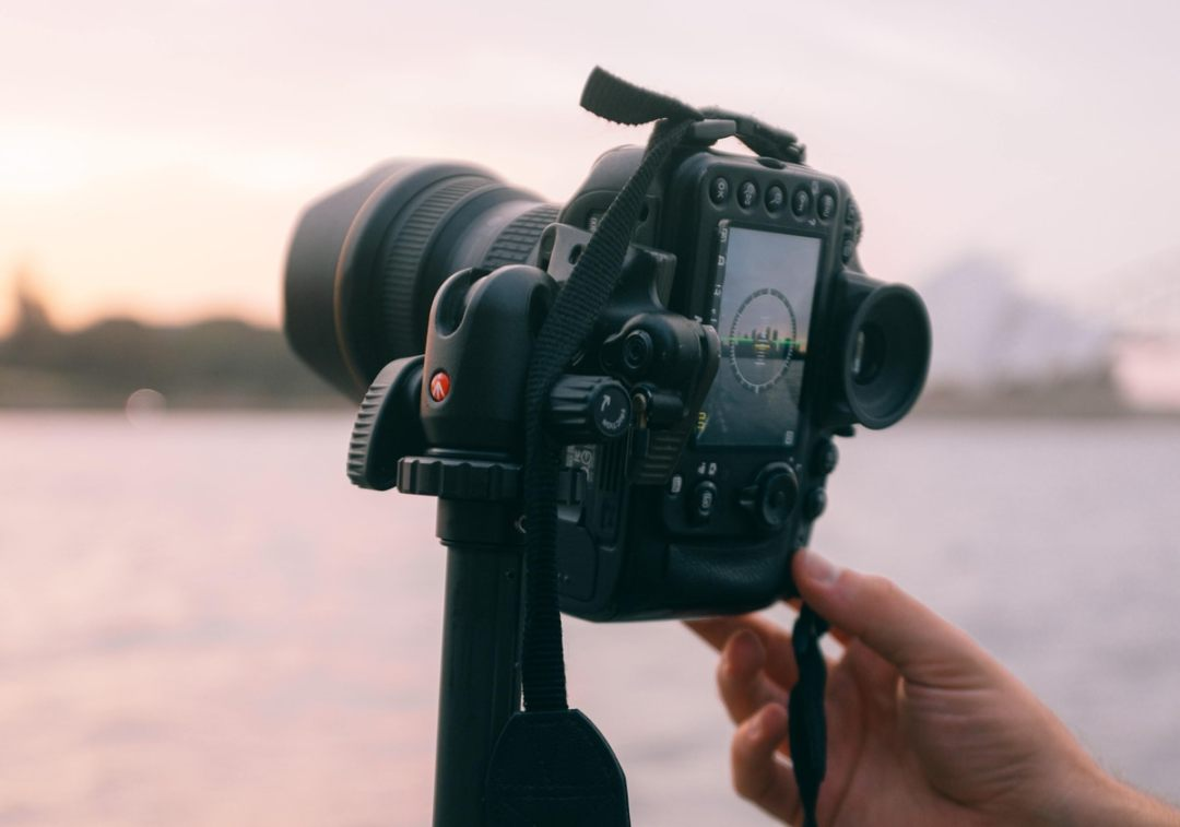 camera taking photo with tripod