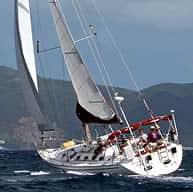 Weatherbird cruising off the shore of a Caribbean island