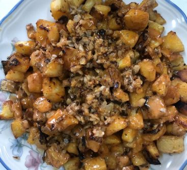 Home made patatas bravas with crispy potatoes, sauce, and topped with a garlic and onion fry. An easy spanish recipe that is perfect for all occasions
