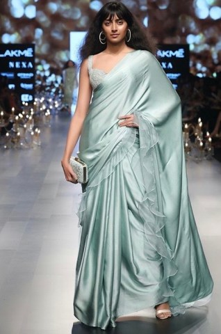 Misty blue satin saree with ruffled organza at the hem. Satin sarees are perfect for beginners.