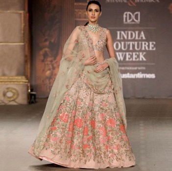 Pink and green bridal lehenga, with shimmer sequins and frost pink tulle. Featured by Shyamal & Bhumika at India Couture Week