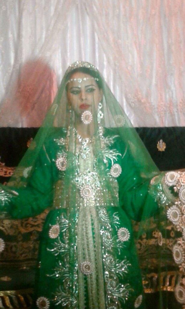 Bruden i sin grønne kjole