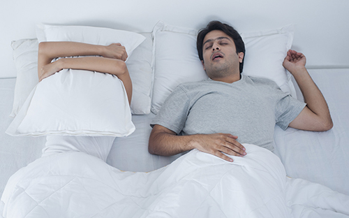Does Sleeping On Your Back Really Make You Snore