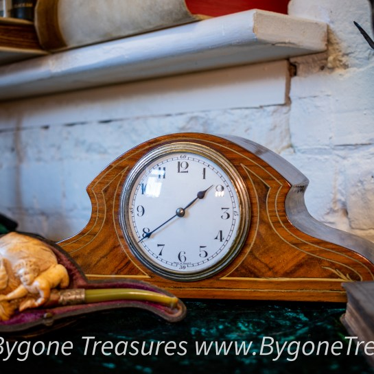 Napoleon style clock with fruit wood inlay and brass button feet
