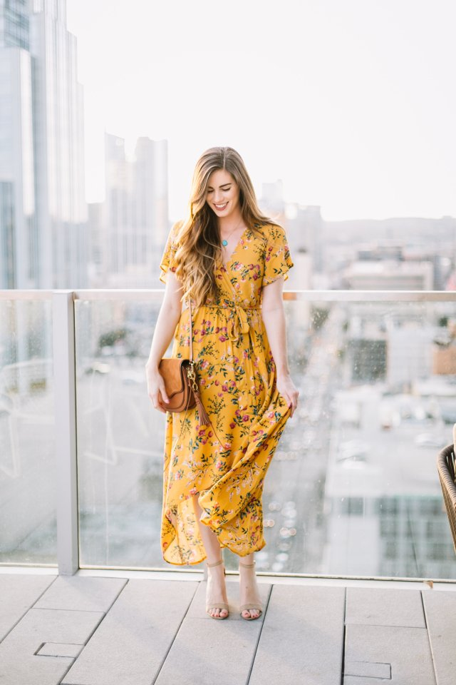 Florals for Spring | Yellow floral wrap dress by Morning Lavender on the rooftop of the Westin Downtown Austin | By Hilary Rose